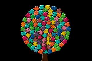 arbre dont les feuilles sont représentées sous forme de pièces de puzzle coloriées